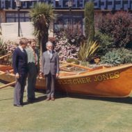 L-R David Jones, Bruce Owen and Neil Symons with the Fletcher Jones surfboat early 1960s. The boat has now been fully restored and is on display at the Warrnambool Surf Club. Photo: shared by David Owen
