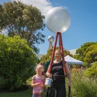 Tonia Wilcox, founder of the Save the Silver Ball and Fletcher's Gardens Facebook page, dressed as the Silver Ball with daughter Jenna,  fundraising at the 2016 community picnic in the FJ gardens for lighting up the silver ball on the city skyline.  Photo: Rosana Sialong