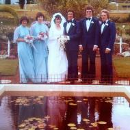 NOT the bridesmaid who fell in the pond! Photo of Glenda McGennan's bridal party in front of the pond in the FJ gardens.