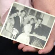 Jean holding the photo of her and Wally Paton on their wedding day.
