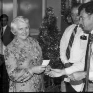 Del Clapp receiving a cheque for the Warrnambool Handicapped Support Group from Fj Staff Rep. Photo: Jones Family Collection