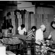 FJ Sydney Staff pack Christmas parcels for the Smith Family.  Photo: Jones Family Collection