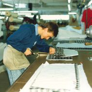 Leigh Bradford cutting a ladies jacket in the 1980s in the cutting room at FJs. Photo: Jones Family Collection