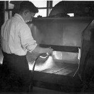 Applying the Siro by hand in a spray booth at FJs, 1962.  Photo: Jones Family Collection