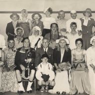 FJ Staff in fancy dress. Back row from left Merv Dowd, Frank Green, Jim Kelly, Graham Boyle, Les Swan, Bob Turner, Ron Oakley. Middle row - from left Chic Phillips, Edgar Hoy, Colin Wayne, Fred Ballinger, George Beasley, Ray Haberfield. Front from left Andy Trench, Lindsey McEwan, George Dorian, Fletcher Jones, Horie Verey, Lawson Ryan and Allan Carter. In front Ray Ryan - Lawson's son. Photo: Alex Wilkins and names supplied by Lawson Ryan