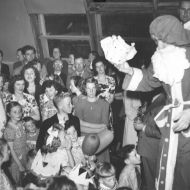 Santa giving presents to the kids at an FJ Christmas Party in the 50s.  Photo: Jones Family Collection