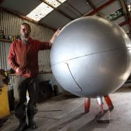 Murray Adams restoring the replica Silver Ball. Photograph by Damian White (The Standard).