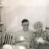 Tim and Peggy Carlton drinking tea in the hammock swing - on holiday at the FJ Port Fairy Bus around 1961.