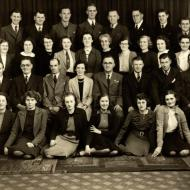 Early Fletcher Jones Staff Photo with Betty Rust sitting to the left of Fletcher Jones second row and fifth from the left. Shared by Wilma Williams